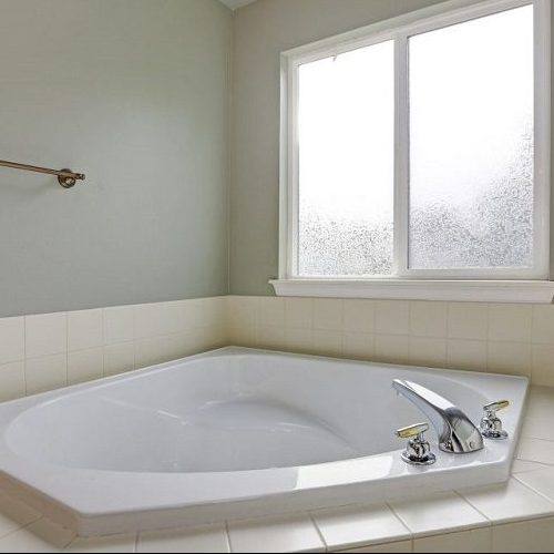 A Picture of a Bathtub That is Surrounded By Tile.