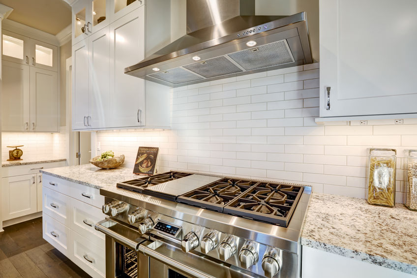 A Picture of a Beautiful Kitchen with a New Subway Tile Backsplash.