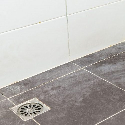 A Picture of a Dirty Tile Floor.