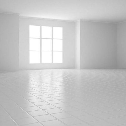 A Picture of an Empty White Room with Square Windows and a Tiled Floor.