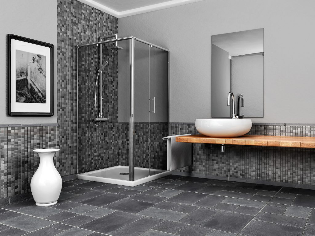 A Picture of a Large Bathroom with a Stone and Mosaic Grey Tone Tile.