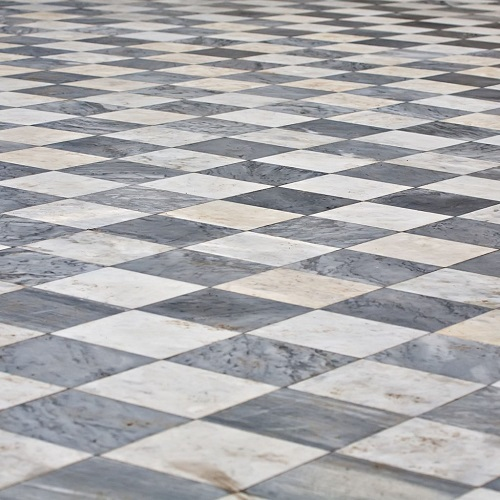 A Picture of a Marble Square Tile Floor.