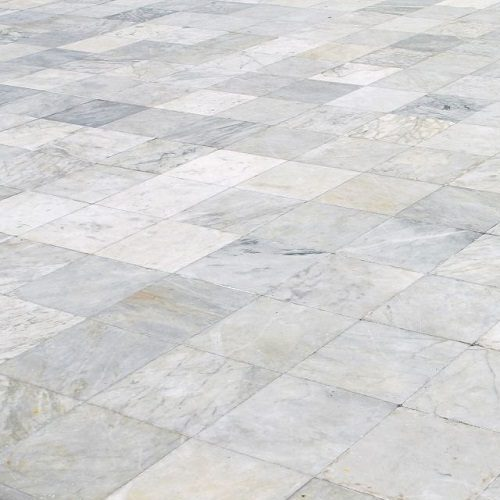A Picture of a Marble Tile Floor.