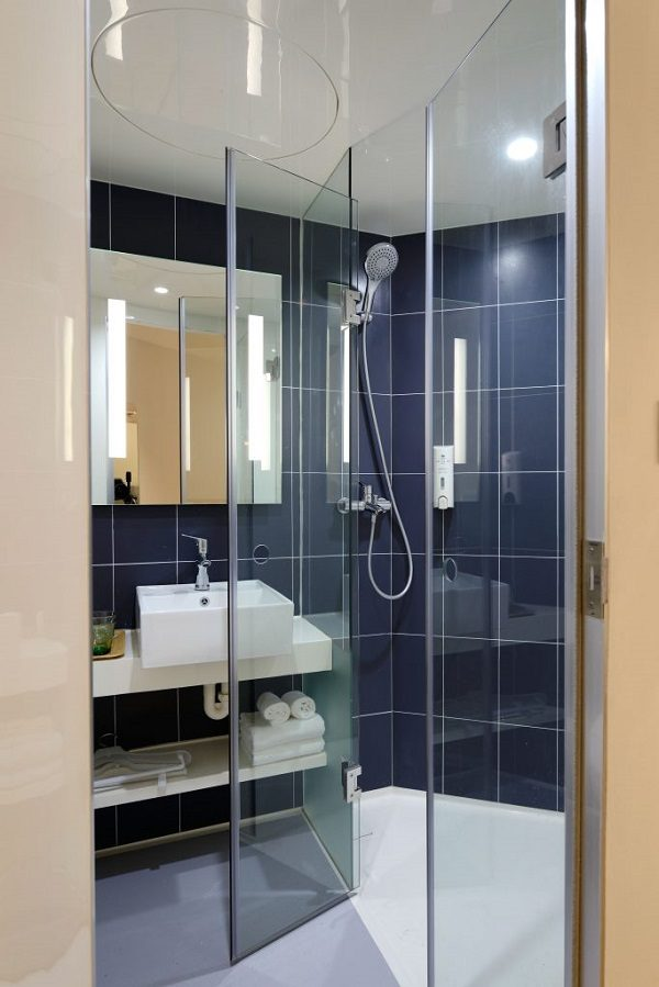 A Shower with Blue Tile.