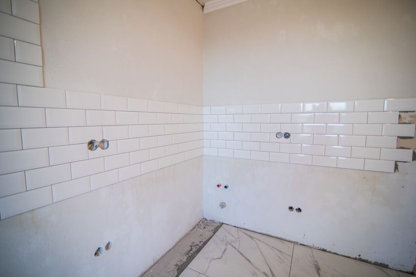 A Picture of Stylish White Ceramic Tile in a Bathroom.