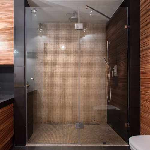 A Picture of a Luxury Shower That Has Wooden Details.